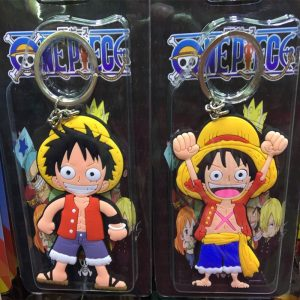 Photo of two different One Piece Luffy keychains in their packaging, taken at a physical store