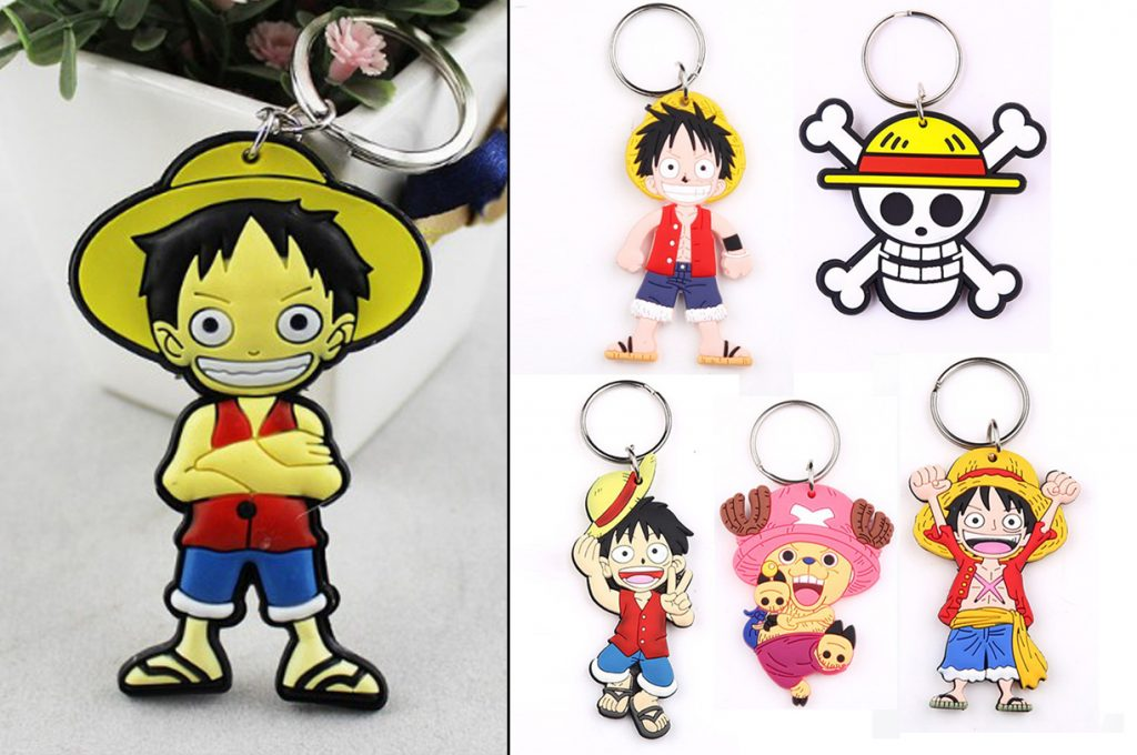 A bunch of poor-quality fake One Piece keychains, including different versions of Luffy and other characters