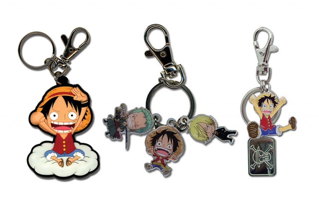 Three examples of Great Eastern Entertainment One Piece keychains, including Luffy and other characters