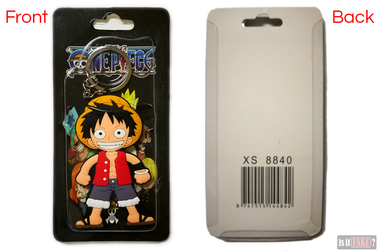 A look at the front and back of the fake One Piece Luffy keychain in its packaging