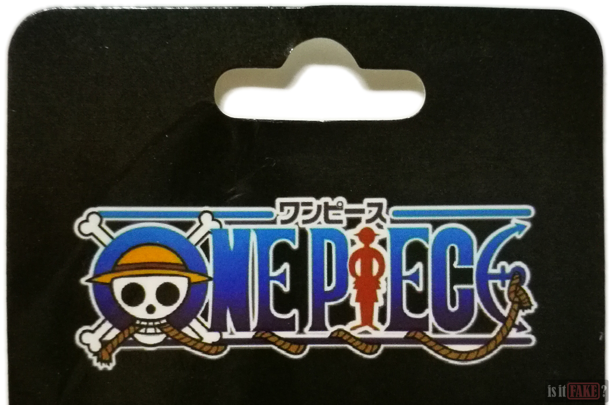 Close-up of the fake One Piece Luffy keychain's cardboard insert, with a focus on the One Piece title/logo