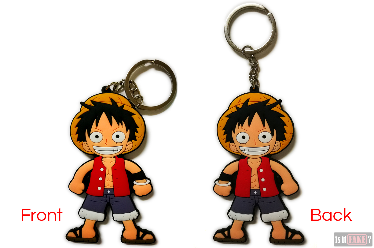 The fake One Piece Luffy keychain, out of its packaging, shown from the front and back