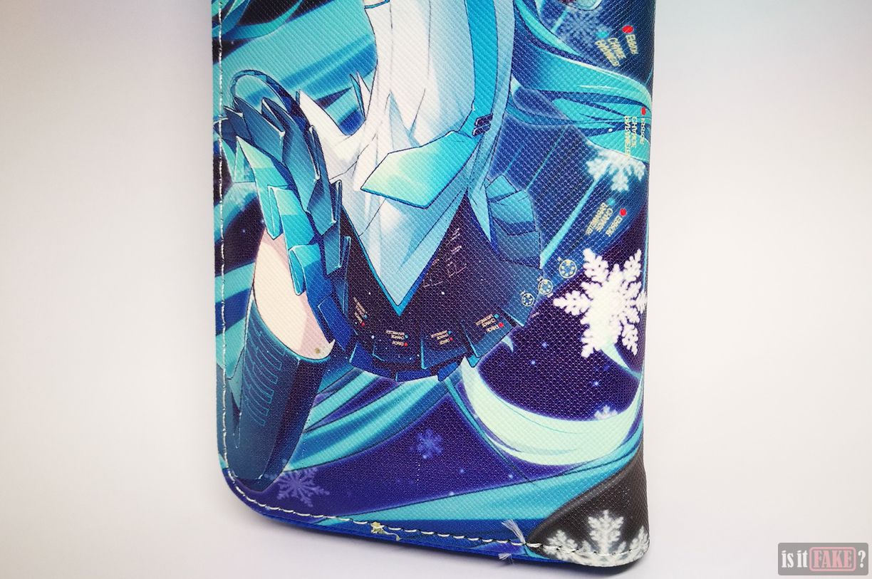 Close-up of fake Hatsune Miku wallet with strap detached