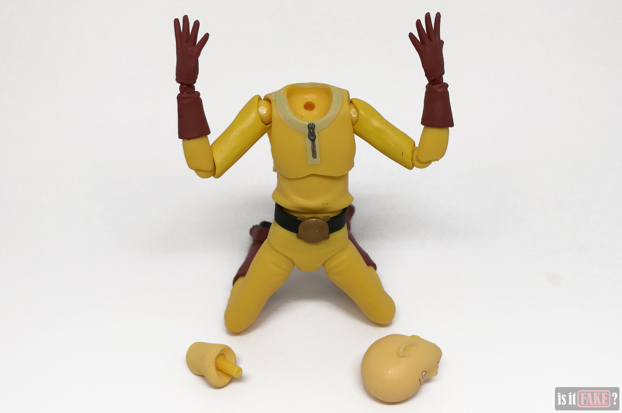 Fake Figma One Punch Man figure posed, with loose neck and head detached