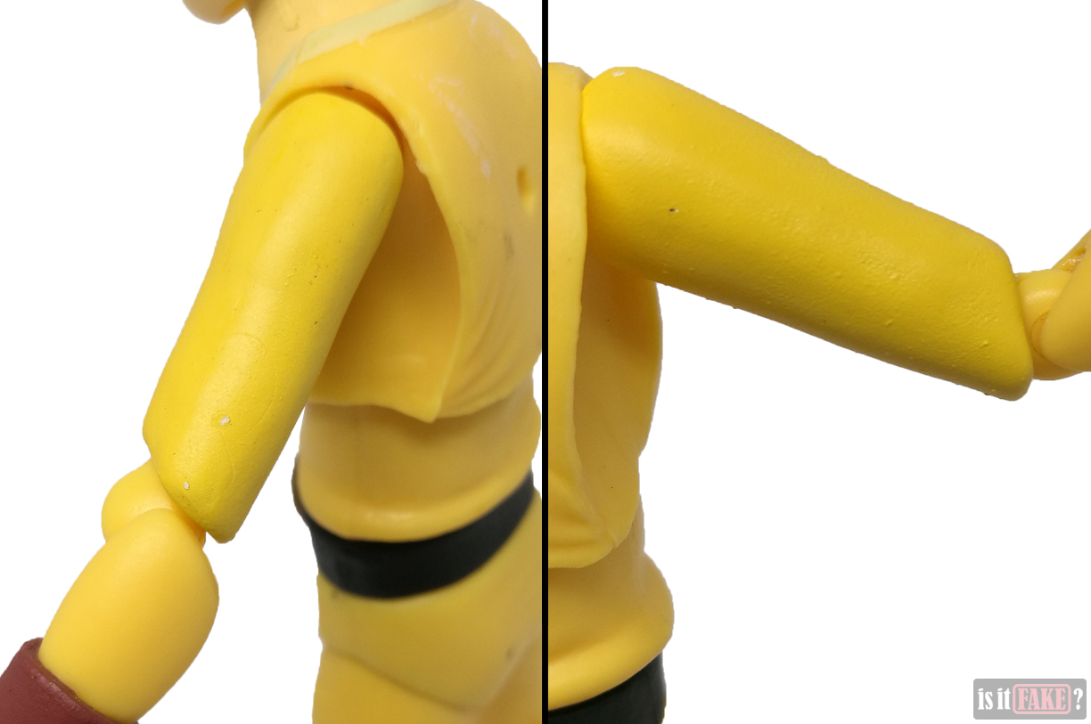 Close-ups of fake Figma One Punch Man figure's arms, back view