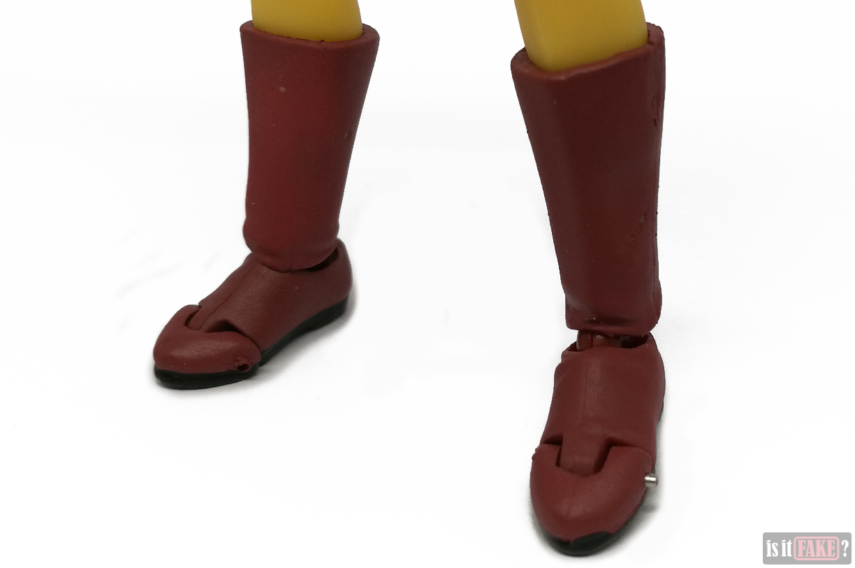 Close-up of fake Figma One Punch Man figure's feet