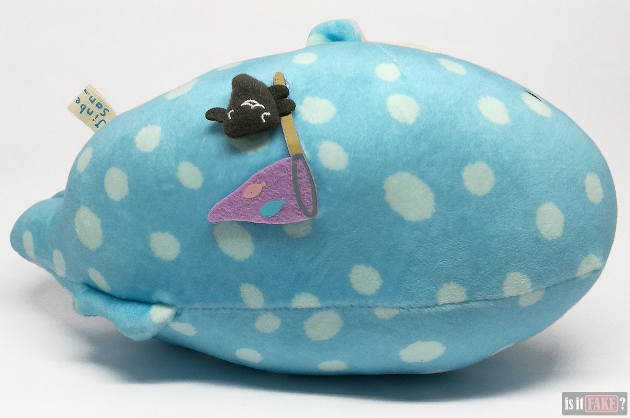 Top of fake San-X Jinbei plush doll