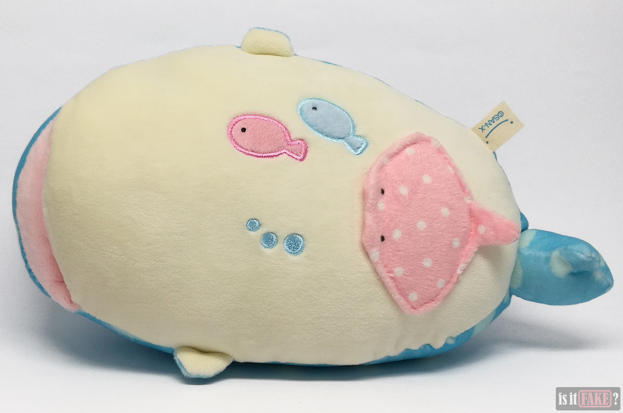 Bottom of fake San-X Jinbei plush doll